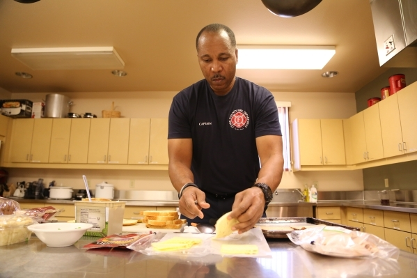 Capt. Michael Lee of the Clark County Fire Department station 28 butters bread for paninis for lunch for platoon #3 in Summerlin, Wednesday, Dec. 30, 2015 in Las Vegas. Rachel Aston/Las Vegas Revi ...