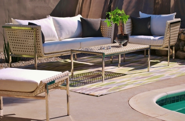 The Twin Palms collection by outside/in features a modern design with a wicker/rattan base and seat cushions with quick-dry foam. COURTESY