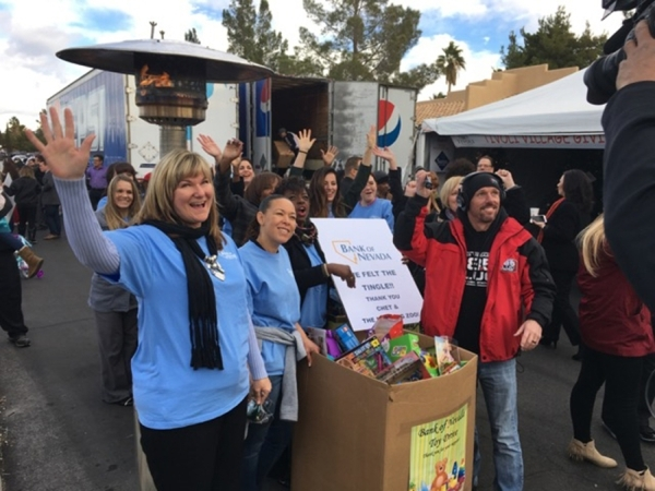 Bank of Nevada employees collected more than 300 toys from coworkers during the bankþÄôs annual holiday party. The gifts were delivered to the annual KLUC/Chet Buchanan toy drive for dist ...