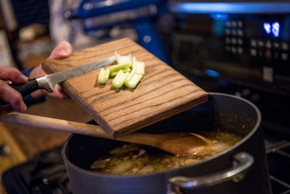 Celery is added to a pot of soup at a home in Las Vegas on Sunday, Jan. 3, 2015. Joshua Dahl/Las Vegas Review-Journal