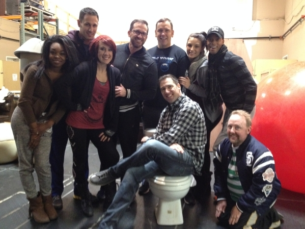 "The cast of ""Spoofical"" surrounds producer and creator David Saxe, seated on the toilet that serves as a clue to the kind of humor that will be involved in the show due in February. Mike ..."