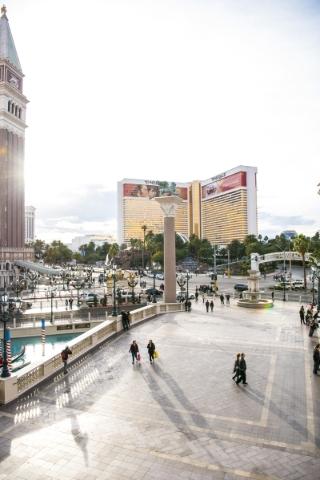 Pedestrians are seen walking in front of the Venetian hotel-casino in Las Vegas on Sunday, Jan. 3, 2015. Joshua Dahl/Las Vegas Review-Journal