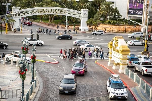 Pedestrians cross the road in front of the Venetian hotel-casino in Las Vegas on Sunday, Jan. 3, 2015. Joshua Dahl/Las Vegas Review-Journal