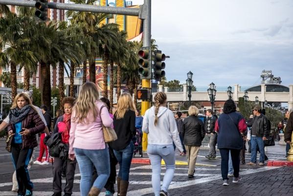 "Pedestrians cross the road in front of the Venetian hotel-casino in Las Vegas as a ""do not cross"" sign is lit on Sunday, Jan. 3, 2015. Joshua Dahl/Las Vegas Review-Journal"