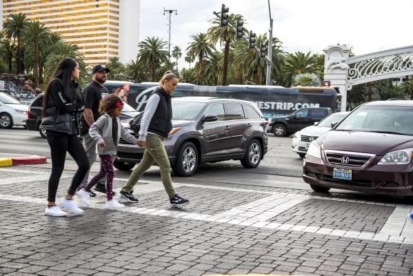 Pedestrians cross in front of cars enterting the Venetian hotel-casino in Las Vegas on Sunday, Jan. 3, 2015. Joshua Dahl/Las Vegas Review-Journal