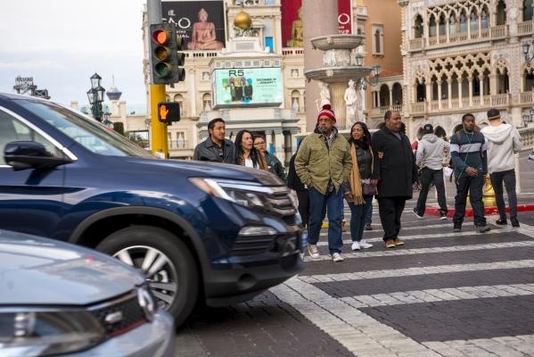 Pedestrians cross in front of cars entering the Venetian hotel-casino in Las Vegas on Sunday, Jan. 3, 2015. Joshua Dahl/Las Vegas Review-Journal