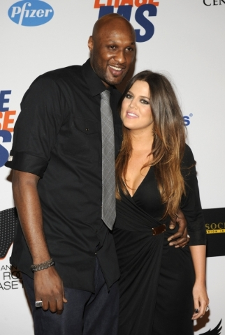 Lamar Odom (L), basketball player with the Dallas Mavericks of the NBA, and his wife Khloe Kardashian-Odom arrive for the 19th annual Race to Erase MS Gala in Los Angeles in this May 18, 2012, fil ...