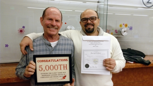 Ronald Bauman and Dumitru Alexeev of Phoenix pose for a photo in Las Vegas on Thursday, Dec. 31, 2015, after they received the 5,000th marriage license issued to a same-sex couple in Clark County. ...