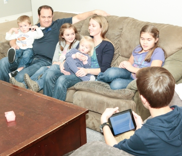 The Scow family, from left, Spencer, 3, Brad, father, Jane, 7, Macy, 1, Julie, mother, and Bailey, 10, talk during the lesson presented by Caleb, 13, right, on Family Night at their Las Vegas home ...