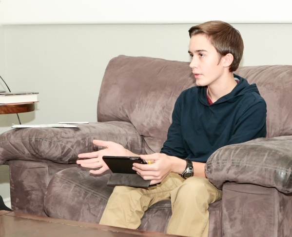 Caleb Scow, 13, leads a discussion on Family Night at his family's Las Vegas home Wednesday, Dec. 16,  2015. The Church of Jesus Christ of Latter-day Saints encourages families to spend spec ...