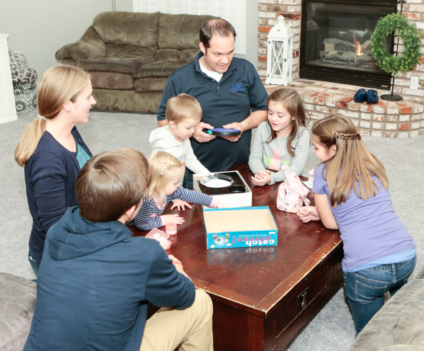 The Scow family, from left, Julie, mother, Caleb, 13, Macy, 1, Spencer, 3, Brad, father, Jane, 7, and Bailey, 10, play a game on Family Night at their Las Vegas home  Wednesday, Dec. 16,  2015. Th ...