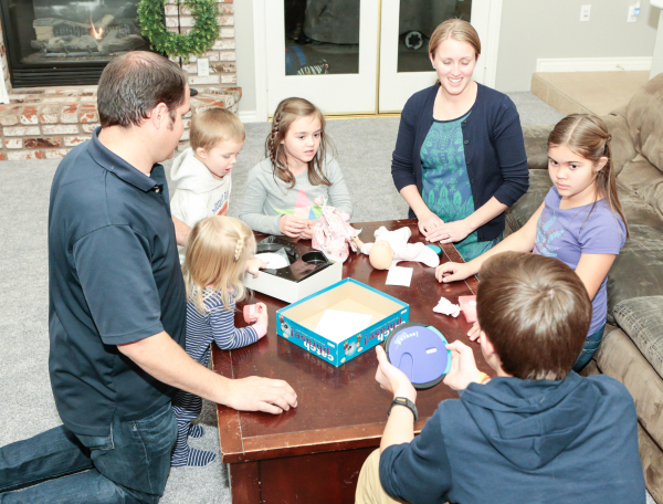 The Scow family, from left, Brad, father, Spencer, 3, Macy, 1, Jane, 7, Julie, mother, Caleb, 13, and Bailey, 10, play a game on Family Night at their Las Vegas home Wednesday, Dec. 16,  2015. The ...