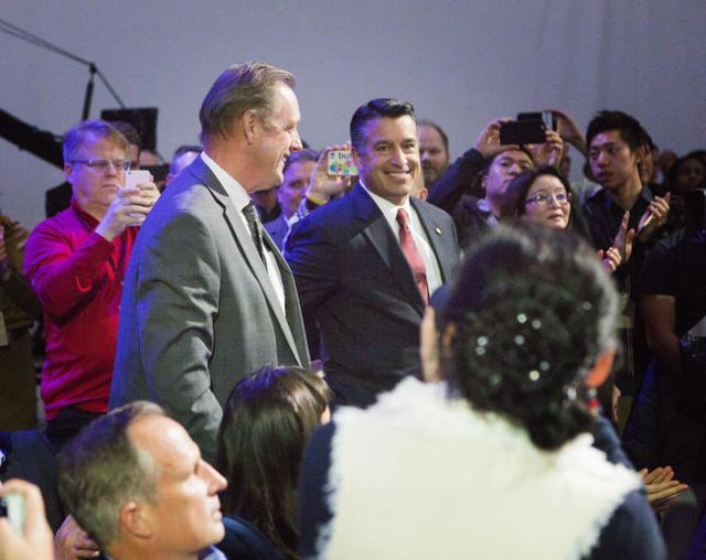 North Las Vegas Mayor John Lee, left, and Nevada Gov. Brian Sandoval are introduced during the unveiling of the Faraday Future FFZero1 prototype at the Las Vegas Village Lot, 3901 Las Vegas Boulev ...