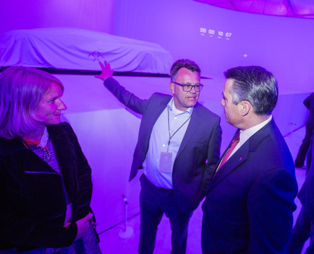 Faraday Future executive Dag Reckhorn, left, talks to Nevada Gov. Brian Sandoval during the unveiling of the FFZero1 prototype at the Las Vegas Village Lot, 3901 Las Vegas Boulevard South on Monda ...