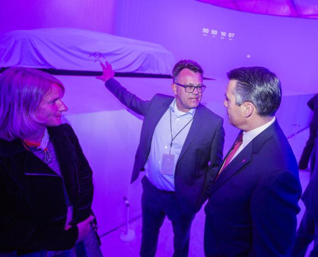 Faraday Future executive Dag Reckhorn, left, talks to Nevada Gov. Brian Sandoval during the unveiling of the FFZero1 prototype at the Las Vegas Village Lot, 3901 Las Vegas Boulevard South on Monda ...