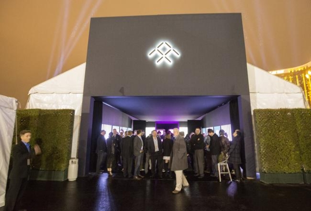Members of the media and invited guests arrive at the unveiling of the FFZero1 prototype at Las Vegas Village Lot, 3901 Las Vegas Boulevard South on Monday, Jan. 4, 2016. Faraday is scheduled to b ...