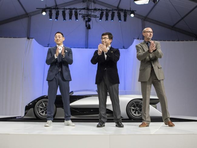 Faraday Future executives Richard Kim, left, head of global design, Ding Lei, co-founder, global vice chairman, See Plan, LETV, and Nick Sampson, SVP R&D and product development,  during the u ...