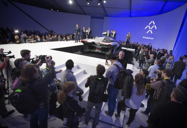 Media and guests gather around the Faraday Future FFZero1 prototype at Las Vegas Village Lot, 3901 Las Vegas Boulevard South on Monday, Jan. 4, 2016. Faraday is scheduled to build a $1 billion pro ...
