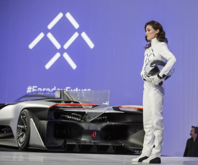 A model stands beside the Faraday Future FFZero1 prototype at Las Vegas Village Lot, 3901 Las Vegas Boulevard South on Monday, Jan. 4, 2016. Faraday is scheduled to build a $1 billion project at A ...
