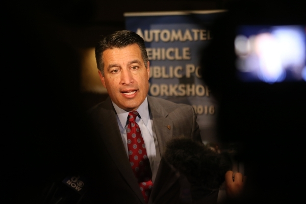 Gov. Brian Sandoval speaks to media during the Automated Vehicle Public Policy Workshop at the Golden Nugget casino-hotel Tuesday, Jan. 5, 2016, in Las Vegas. (Erik Verduzco/Las Vegas Review-Journ ...