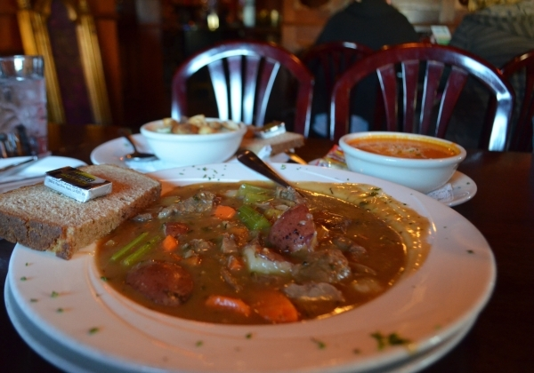 McMullan's Irish Pub's menu features, clockwise from front, Diddy's Irish Stew, a hearty braised lamb and vegetable dish; soups of the day such as tomato; and potato soup. Ginger ...