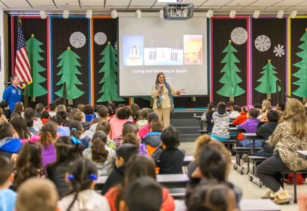 Clark County School District School Community and Partnership Program Coordinator, Cheryl Wagner, center, introduces former NASA astronaut Dr. Don Thomas, left, at McMillan Elementary School in La ...