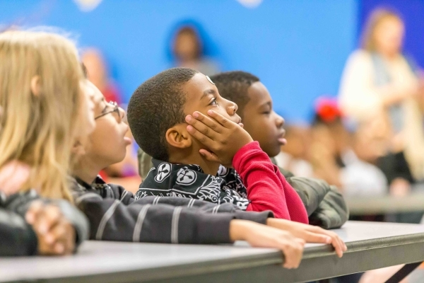 Katz Elementary School third grader, Jayshawn, 8, center, listens to a presentation by former NASA astronaut Dr. Don Thomas about living and working in space at the James B. McMillan Elementary Sc ...