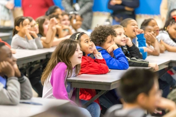 Third graders from Katz and McMillan elementary schools listen to a presentation by former NASA astronaut Dr. Don Thomas about living and working in space at McMillan Elementary School in Las Vega ...