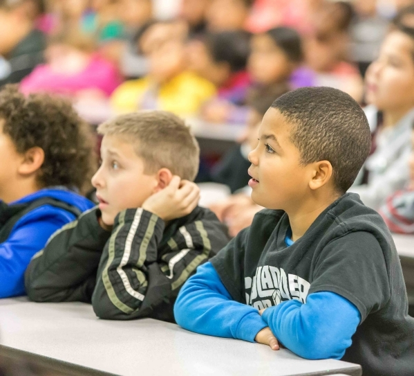 McMillan Elementary School third graders Lorenzo, 9, right, and Joshua, 9, watch a presentation by Former NASA astronaut Dr. Don Thomas,about living and working in space during a presentation at t ...