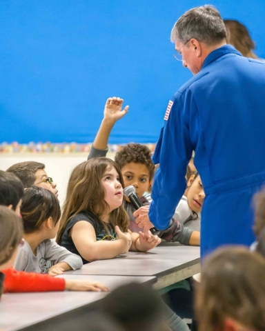 McMillan Elementary third grader Jade, 9, asks former NASA astronaut Dr. Don Thomas, right, a question about living and working in space during a presentation at the school in Las Vegas on Wednesd ...