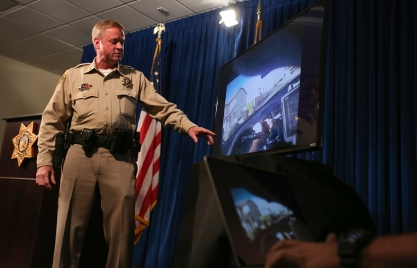 Las Vegas Metropolitan Police Department Undersheriff Kevin McMahill shows members of the media body cam footage from the New Year's Eve officer involved shooting at Metro Headquarters in La ...