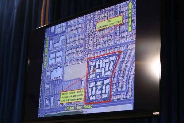 An overhead of the area where a the New Year's Eve officer involved shooting took place is shown on a TV as Las Vegas Metropolitan Police Department Undersheriff Kevin McMahill talks to the  ...