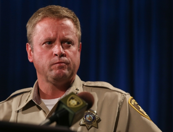 Las Vegas Metropolitan Police Department Undersheriff Kevin McMahill watches body cam footage from the New Year's Eve officer involved shooting as it is shown to members of the media at Metr ...