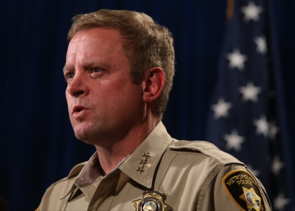 Las Vegas Metropolitan Police Department Undersheriff Kevin McMahill talks to members of the media about the New Year's Eve officer involved shooting at Metro Headquarters in Las Vegas on Mo ...