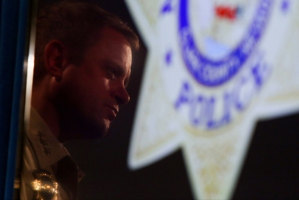 Las Vegas Metropolitan Police Department Undersheriff Kevin McMahill is reflected in a TV as he talks to the media about the New Year's Eve officer involved shooting at Metro Headquarters in ...
