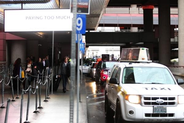 People board taxi cabs at McCarran International Airport Terminal 1 on Tuesday, Jan. 5, 2016 in Las Vegas. Erik Verduzco/Las Vegas Review-Journal Follow @Erik_Verduzco
