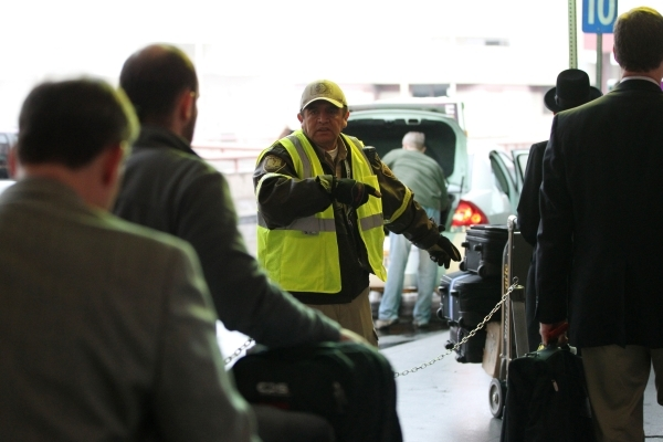 David Torres, transportation specialist, directs people to taxis cabs at McCarran International Airport Terminal 1 on Tuesday, Jan. 5, 2016 in Las Vegas. Erik Verduzco/Las Vegas Review-Journal Fol ...