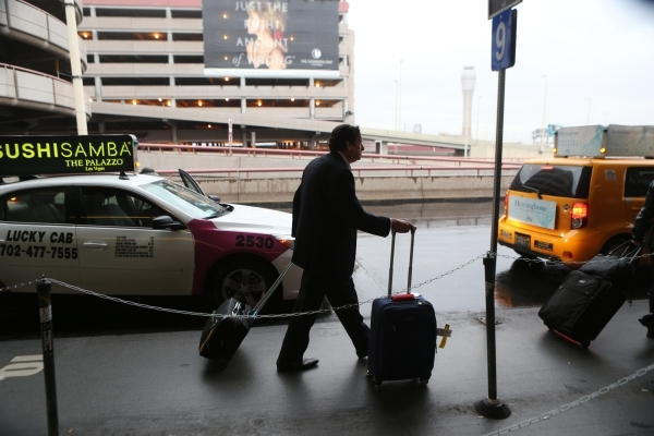A passenger walks to a taxi cab at McCarran International Airport Terminal 1 on Tuesday, Jan. 5, 2016 in Las Vegas. Erik Verduzco/Las Vegas Review-Journal Follow @Erik_Verduzco