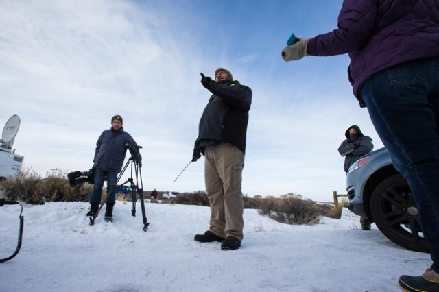 An anti-government protestor speaks to news media by the entrance of Malheur National Wildlife Refuge headquarters, which the group is occupying, near Burns, Ore. on Monday, Jan. 4, 2016. The prot ...