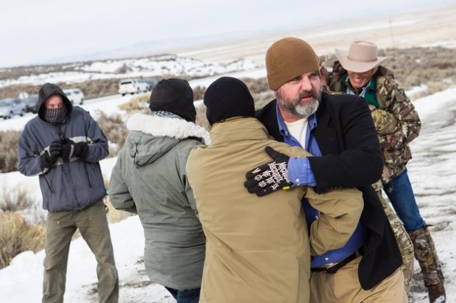 Jason Patrick, right, greets fellow anti-government protestor Jon Ritzheimer at the Malheur National Wildlife Refuge headquarters, which is occupied by the group, near Burns, Ore. on Monday, Jan.  ...
