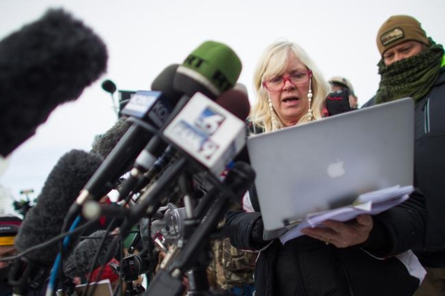 Anti-government protestor Shawna Cox of Utah gives a statement to reporters at a news conference by the entrance of Malheur National Wildlife Refuge near Burns, Ore. on Monday, Jan. 4, 2016. The p ...