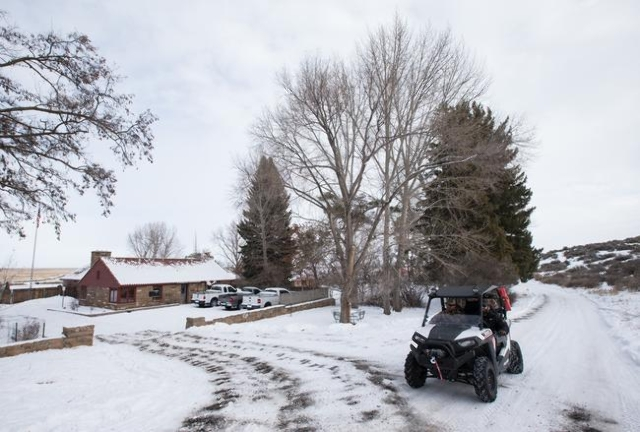 Anti-government protestors drive an all-terrain vehicle at Malheur National Wildlife Refuge headquarters, which the group is occupying, near Burns, Ore. on Monday, Jan. 4, 2016. The protestors, ma ...