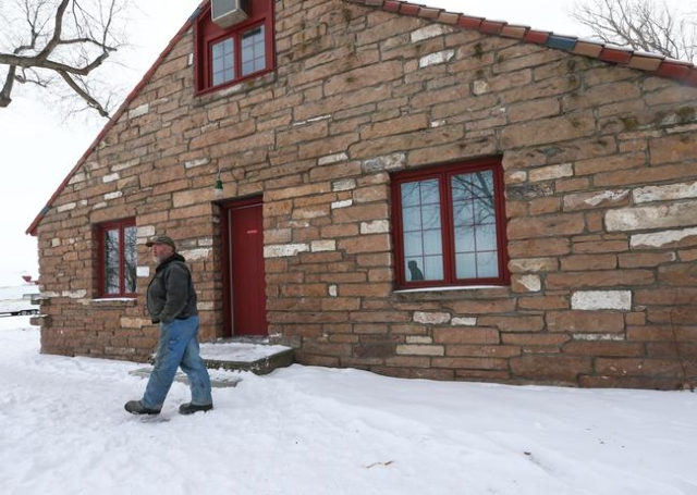 An anti-government protestor stands by a building at the Malheur National Wildlife Refuge headquarters, which the group is occupying, near Burns, Ore. on Monday, Jan. 4, 2016. The protestors, many ...