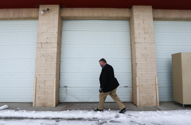 Anti-government protestor Jason Patrick walks by a building at the Malheur National Wildlife Refuge headquarters, which the group is occupying, near Burns, Ore. on Monday, Jan. 4, 2016. The protes ...