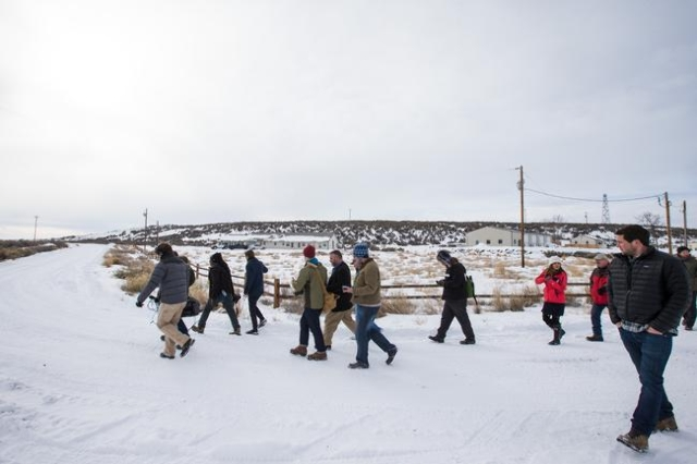 News media members walk through the Malheur National Wildlife Refuge headquarters, which is occupied by anti-government protestors, near Burns, Ore. on Monday, Jan. 4, 2016. The protestors, many o ...
