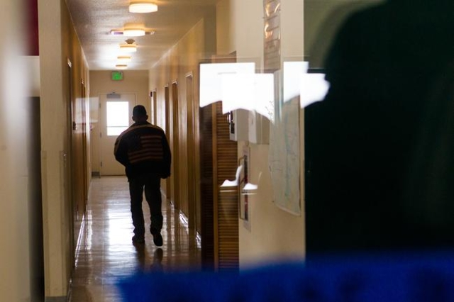 Anti-government protestor Duane Ehmer of Irrigon, Ore. walks down a hallway in a building at the Malheur National Wildlife Refuge headquarters, which is occupied by the group, near Burns, Ore. on  ...