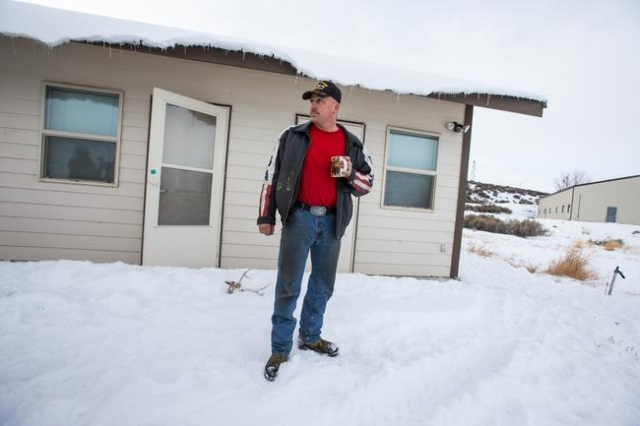 Anti-government protestor Duane Ehmer of Irrigon, Ore. stands outside of a building at the Malheur National Wildlife Refuge headquarters, which is occupied by the group, near Burns, Ore. on Monday ...