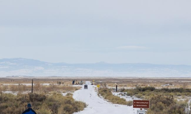 Anti-government protestors drive an all-terrain vehicle down a road from the Malheur National Wildlife Refuge headquarters, which is occupied by the group, near Burns, Ore. on Monday, Jan. 4, 2016 ...