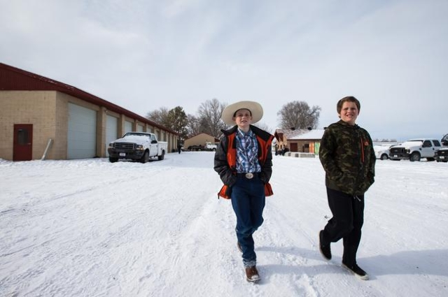 Burns, Ore. residents Spencer Johnson, 11, left, and Travis Keady, 13, explore the Malheur National Wildlife Refuge headquarters, which is occupied by anti-government protestors, as they visit wit ...
