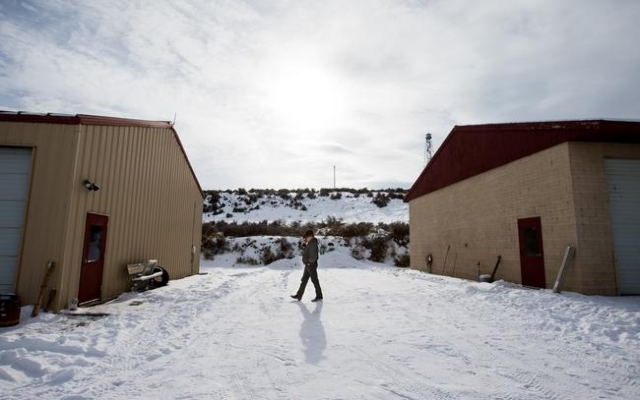 A man takes a phone call at the Malheur National Wildlife Refuge headquarters, which is occupied by anti-government protestors, near Burns, Ore. on Monday, Jan. 4, 2016. The protestors, many of th ...